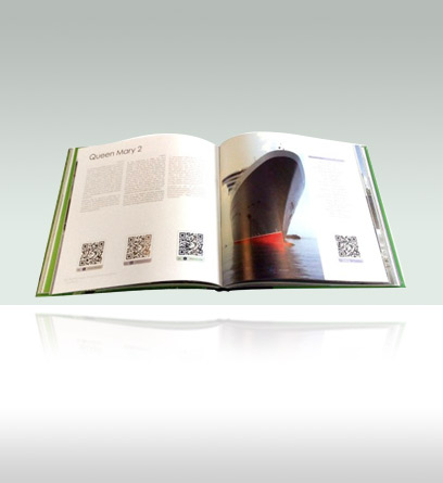 a book opened to a page with QR codes